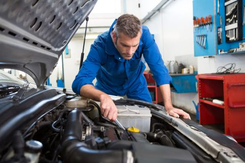 Technician working on engine